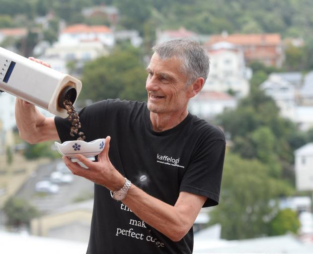 Chris Hilder pours beans from a coffee roaster into a bowl at a demonstration  featuring the new Kaffelogic Nano 7 at the Dunedin Public Library. Photo: Linda Robertson