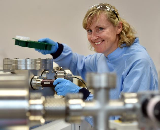 Prof Claudine Stirling with a mass spectrometer machine at the University of Otago chemistry...
