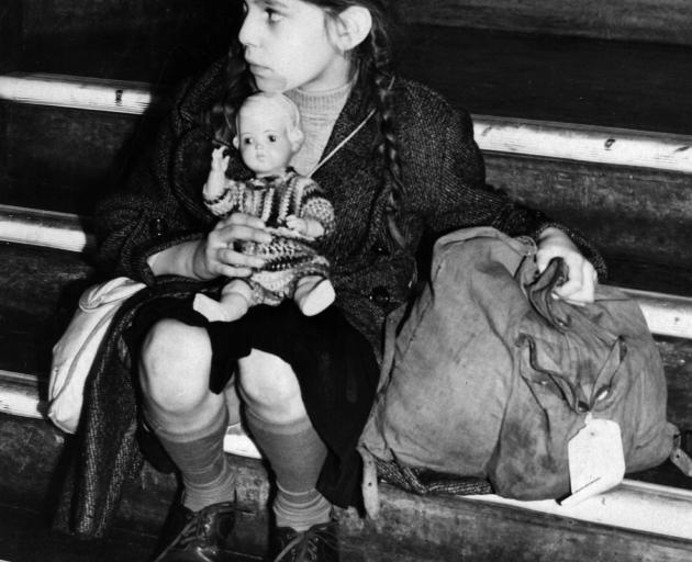 "Tired and alone, an 8-year-old ""kindertransport"" refugee from Germany, arrives in England in 1938..."