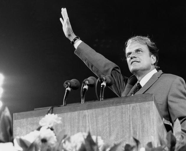 Evangelist Billy Graham preaches the Gospel to thousands of believers at Shea Stadium in Queens,...