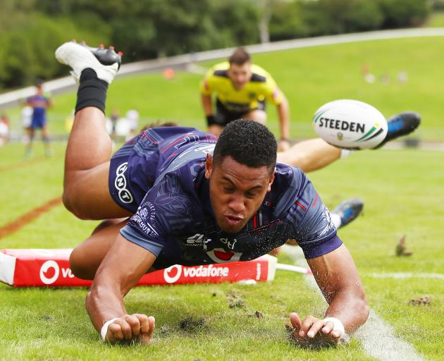 Warriors wing David Fusitu'a dives over to score a try during a trial match against the Melbourne...