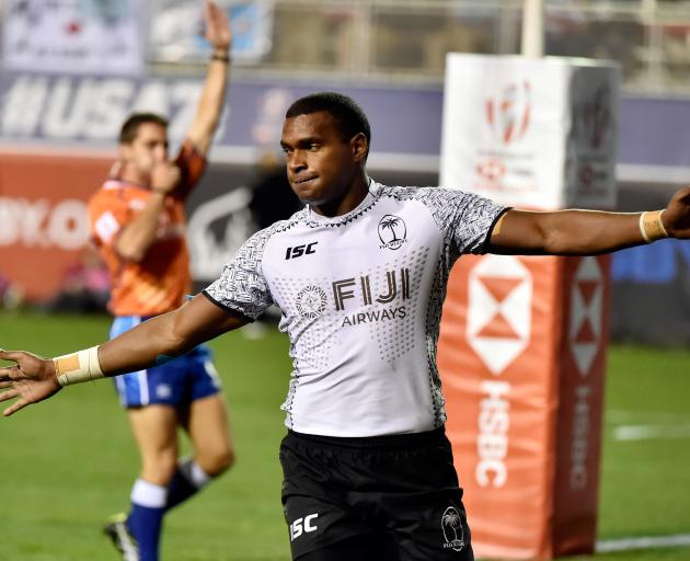 Josua Vakurunabili of Fiji reacts after scoring a try against France during the USA Sevens. Photo...