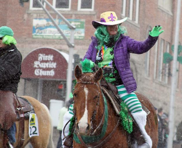 Cowgirls brave the weather to participate in the parade. Photo: Gwyneth Hyndman