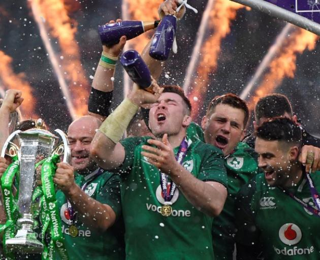 Ireland's Rory Best, Peter O'Mahony and team mates celebrate with the Six Nations trophy during the presentation at the end of the match. Photo: Reuters