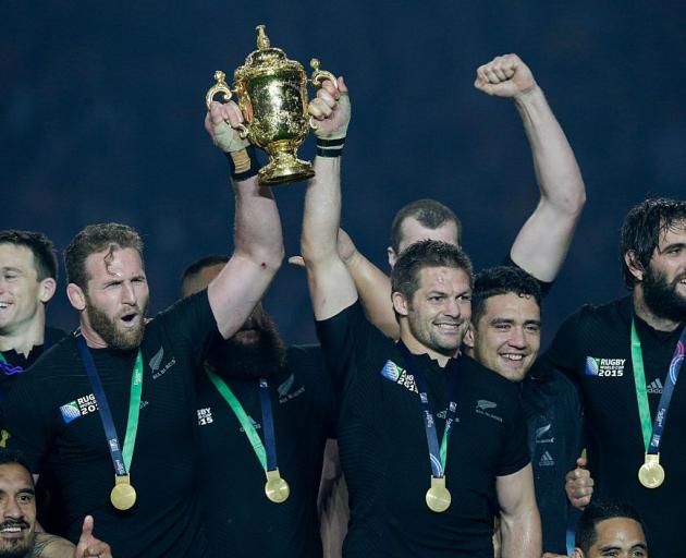 Kieran Read and Richie McCaw lift the William Webb Ellis Trophy after winning the 2015 Rugby...