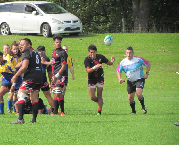 Old Boys halfback Inoke Naufahu clears the ball from a ruck during the Citizens Shield game...