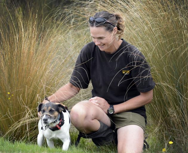 Dog handler Angela Newport and dog Macca finish their search for predators at Orokonui...