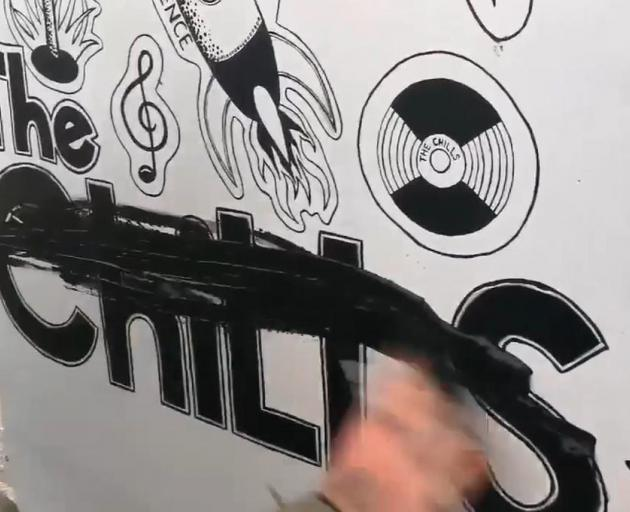 "Still image from a video shows a person vandalising ""The Chills"" powerbox. Photo: Supplied"