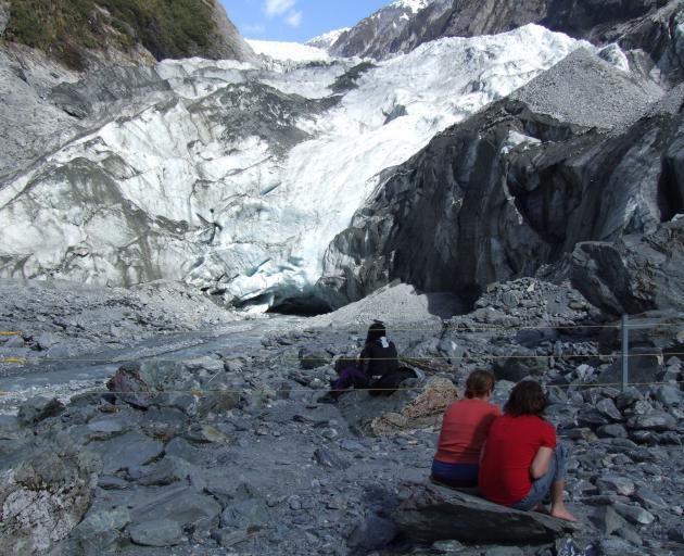 Tourists soak up the atmosphere at Franz Josef glacier. Photo: Matthew Haggart