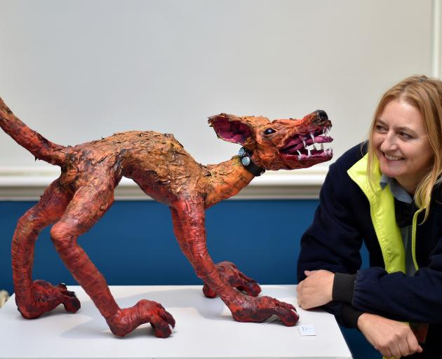 Mosgiel artist Brenda Nyhof shows no fear as she looks her demon dog in the eyes. PHOTO: GREGOR...