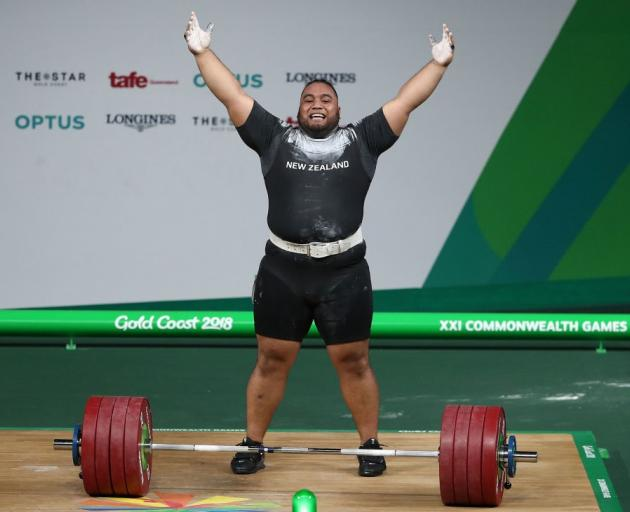 David Liti celebrates after his final lift at the Commonwealth Games last  night. Photo:
