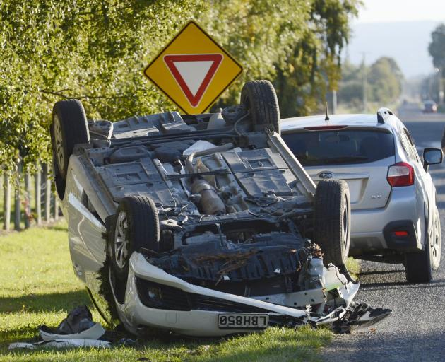 A car lies upside down after a crash on Dukes Rd in Mosgiel  Saturday afternoon. Photo: Gerard O...