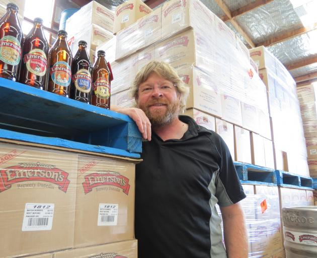 Dunedin brewer Richard Emerson surveys thousands of boxes of beer ready to be delivered ...
