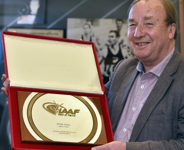 New Zealand Sports Hall of Fame chief executive Ron Palenski holds Peter Snell's IAAF Hall of...