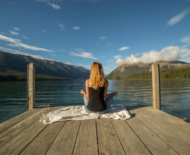 Only some meditations involve sitting quietly with legs crossed. Photo: Getty Images
