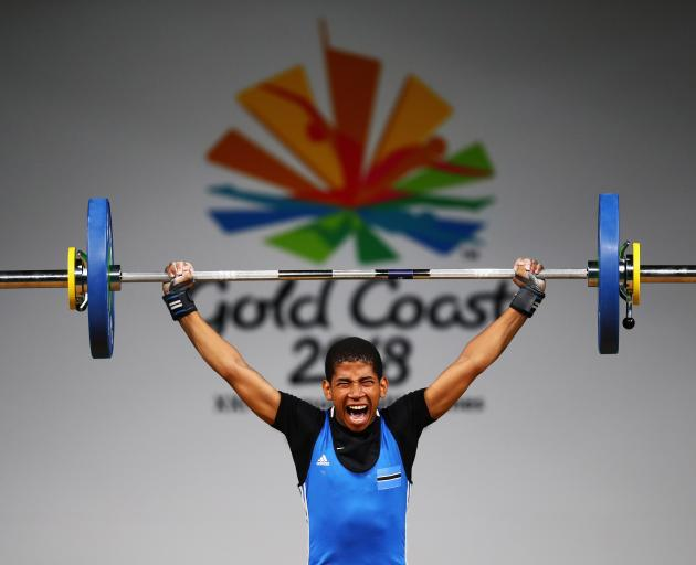 Kgotla Kgaswane of Botswana competes during the Weightlifting Men's 56kg  Final on day one of the