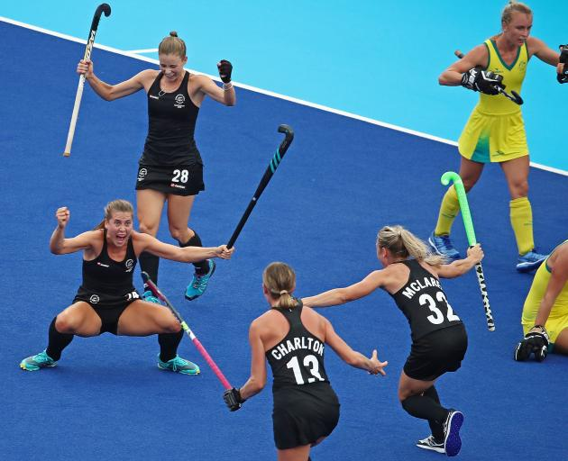Rose Keddell of New Zealand is congratulated by her teammates after scoring their second goal...