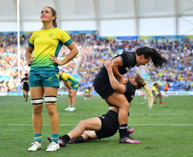 New Zealander Kelly Brazier celebrates with team mates after her last gasp try sealed the gold...