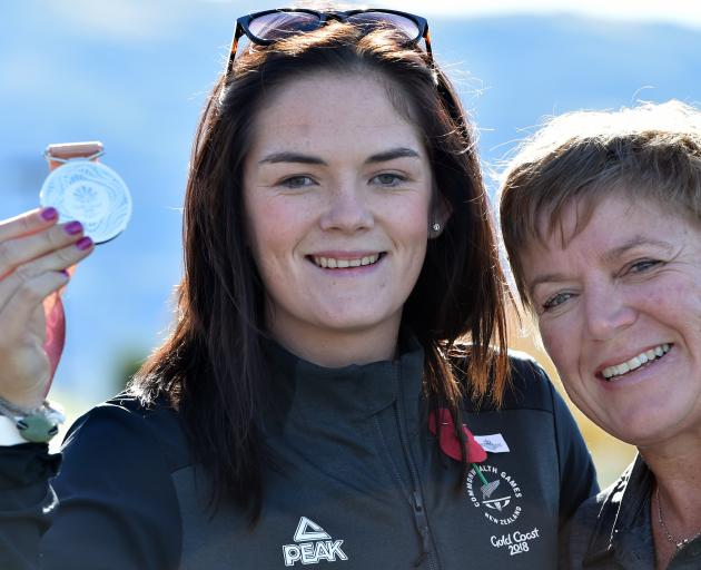 Para-javelin thrower Holly Robinson holds her Commonwealth Games silver medal yesterday alongside coach Raylene Bates at Dunedin Airport. Photo: Peter McIntosh