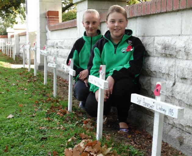 Maheno School pupils Lillie Silcock (11) and Brooke Purvis (11) at the Maheno War Memorial with...