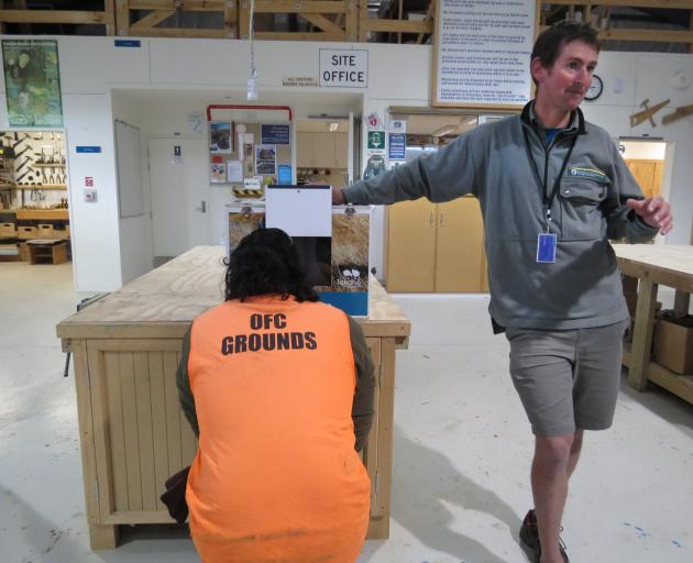 Doc ranger Philip Marsh presents takahe Tumanako to prisoners at the Otago Corrections Facility.