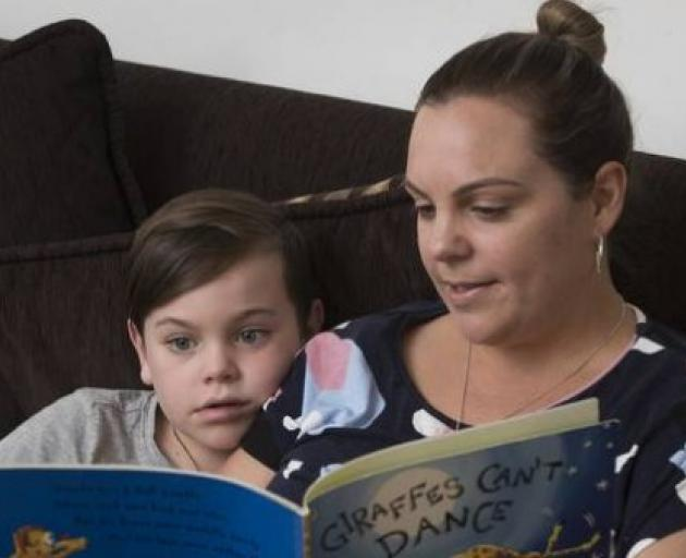 5-year-old Ante Fletcher reads a book with his mother Rebecca Fletcher at home. Photo: NZ Herald