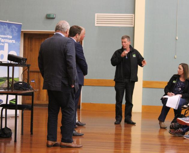 At a public meeting in Gore last week to discuss the swede mix up, Southland Federated Farmers president Allan Baird asks questions as (from left) PGG Wrightson seed and grain group general manager John McKenzie, Clutha-Southland MP Hamish Walker and PGG