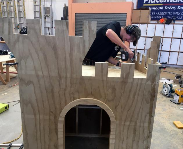 Gray Brothers Builders apprentice Sam Paris, of Shiel Hill, builds a children's castle to win a regional heat in the annual New Zealand Certified Builders Apprentice Challenge in Dunedin on Saturday. Photo: Shawn McAvinue