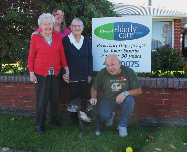 Enjoying a day at the Mosgiel Elderly Care Group are (from left) Joan Blair, manager Kerry Meehan, Rita Wright and activities co-ordinator Brian Jowett, with Zak. Photo: Ella Stokes