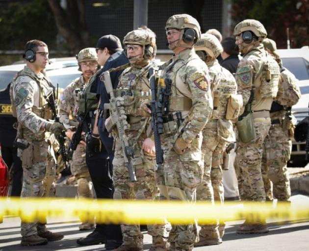 San Mateo County Swat team officers are seen near Youtube headquarters following an active shooter situation in San Bruno, California. Photo: Reuters