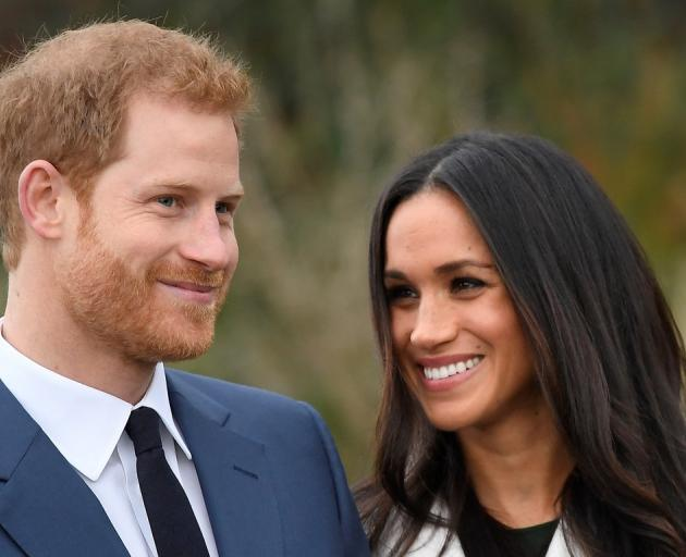 Prince Harry poses with Meghan Markle in the Sunken Garden at Kensington  Palace in London.