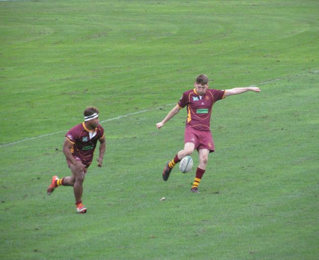 Athletic Marist first five Duncan Jones clears for touch ahead of team-mate Simon Lilicama during...