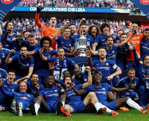 Chelsea celebrate winning the final with the trophy. Photo: Reuters