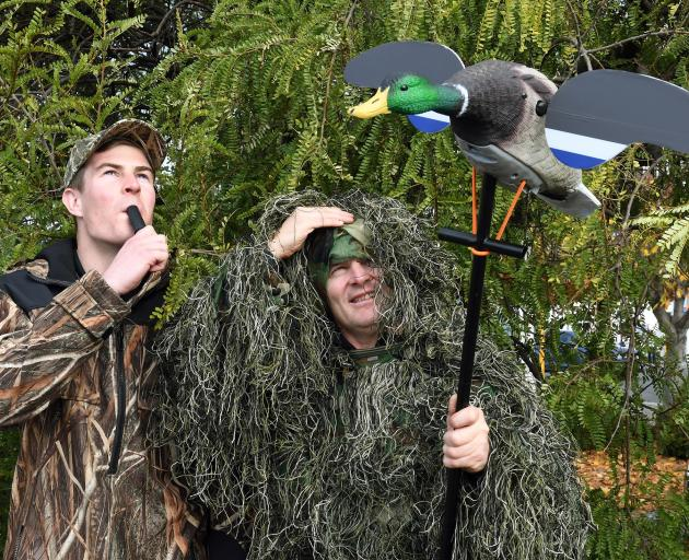 "Hunting and Fishing Dunedin employees Riley Bungard (21, left), a self-described ""game bird sort..."