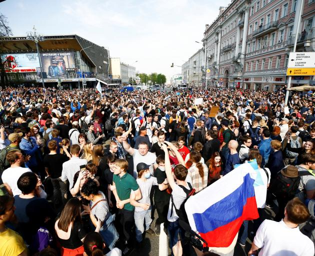 People gather during an opposition rally organized by the opposition leader Alexei Navalny, prior...