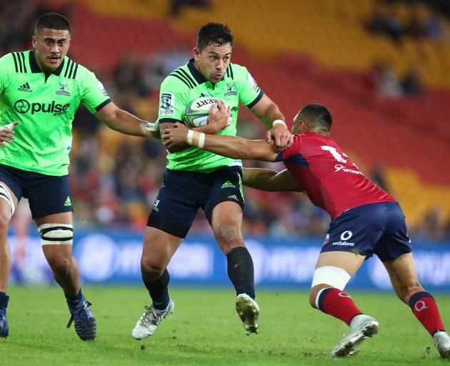 Rob Thompson breaks the line against the Reds in Queensland tonight, Photo: Getty Images