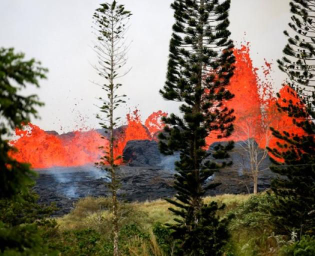 Lava erupts on the outskirts of Pahoa during ongoing eruptions of the Kilauea Volcano in Hawaii