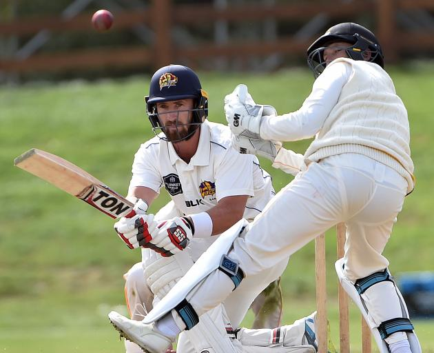 Otago batsman Neil Broom sweeps the ball during a Plunket Shield match against Wellington at the University Oval yesterday. Wellington wicketkeeper Devon Conway watches. Photo: Peter McIntosh