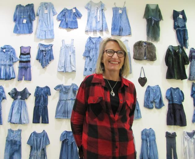 Luggate textile artist Victoria Stevens is flanked by some of the hand-created garments displayed...