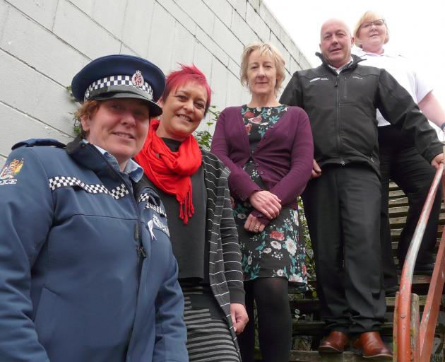 Determined to continue protesting against the recent closure of Roxburgh children's village are, from left, Clutha-Taieri area police response manager Senior Sergeant Cynthia Fairley, South Otago Women's Refuge advocate Kerri Oliver, Anglican Family Care