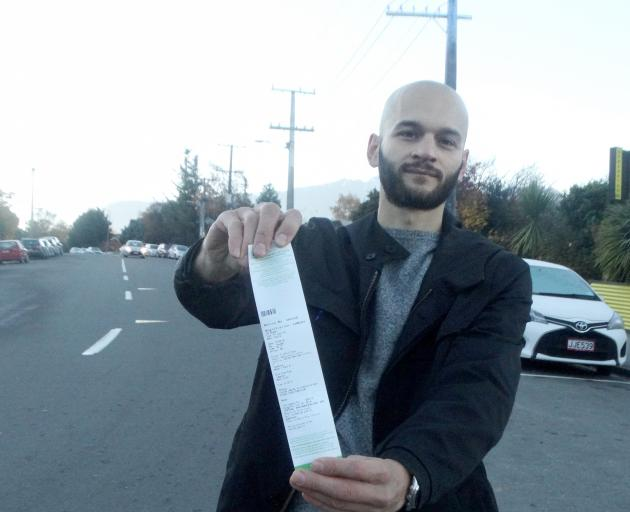 Marco Adreani displays a ticket issued for freedom camping in Queenstown. Photo: Mandy Cooper