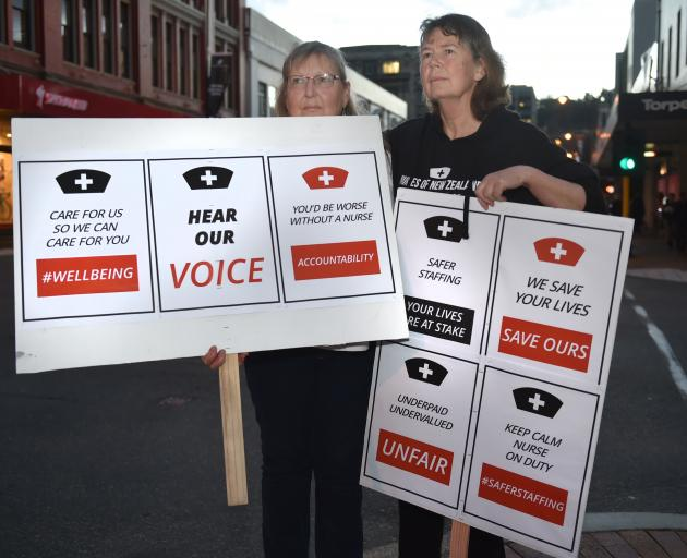 "Dunedin nurses Paula Cooper and Anne Daniels prepare for Saturday's ""Hear Our Voice'' rally. Photo: Gregor Richardson"