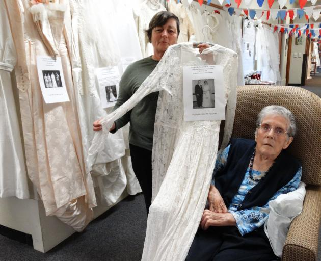 Susan Clark (left) and Evelyn Clarke at Iona Enliven Care Home with the wedding dress they wore...