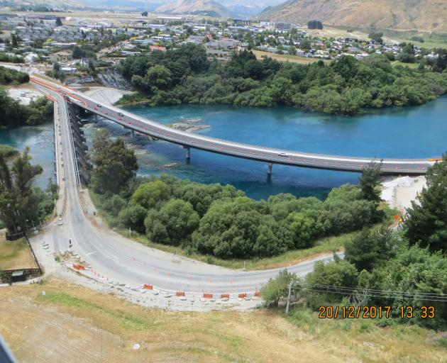 The $22million new curved Kawarau Falls Bridge next to the old structure. And plenty of houses in...