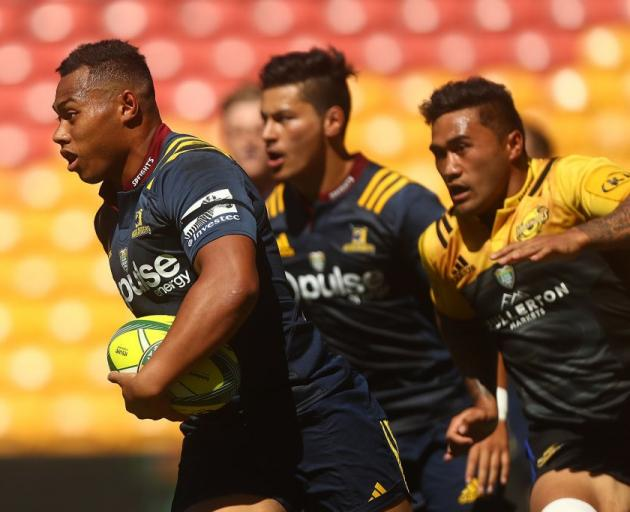 Tevita Li carries the ball as Sio Tomkinson supports him for the Highlanders at the 2017 Brisbane...