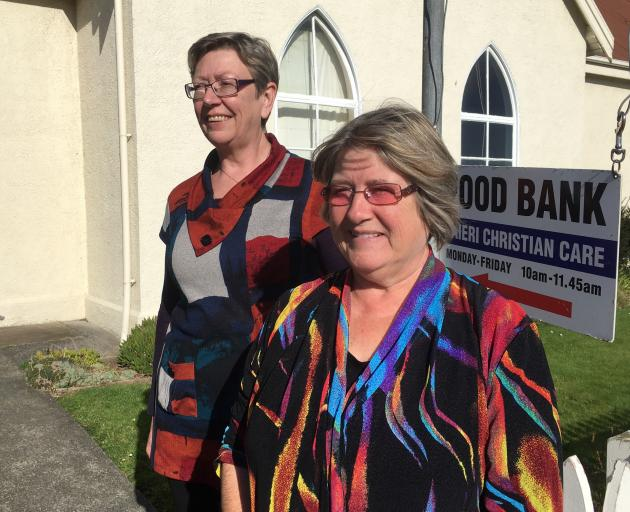 Mosgiel Community Food Bank co-ordinator Michelle Kerr and Taieri Christian Care Trust chairwoman Joy Davis in the entrance to the foodbank in Wickliffe St, Mosgiel last week. PHOTO: SHAWN MCAVINUE