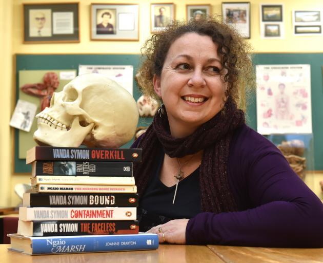 Dunedin crime novelist Dr Vanda Symon with a model skull and several books, including her first novel, Overkill, at the University of Otago's W.D. Trotter Anatomy Museum. Photo: Gregor Richardson