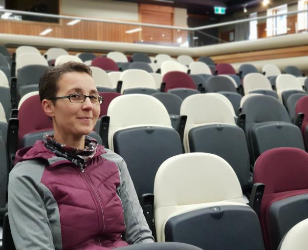 Lake Wanaka Centre co-ordinator Christine Schafer tries out the building's upgraded seating. Photo: Sean Nugent