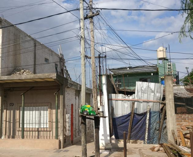 Power cables are strewn across an impoverished residential area in Buenos Aires.