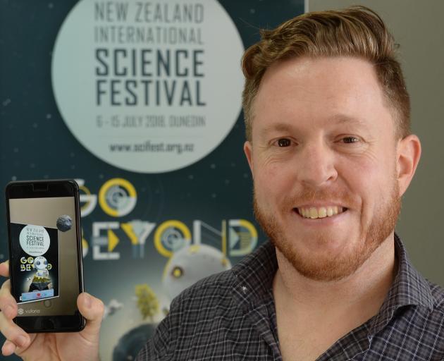 New Zealand International Science Festival director Dan Hendra demonstrates a phone app which...